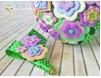 Cocarda Mire - handmade din pasta polimerica: flori portocalii, mov si bleo